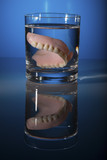 dentures in a teacup