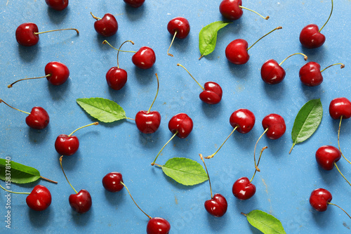 Ripe organic cherry with green leaves