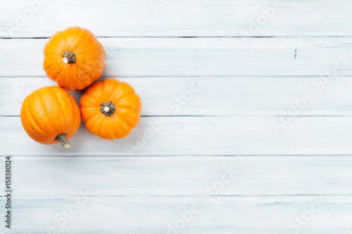 Autumn pumpkins on wooden table - 158380124