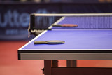 Table tennis table with racquet