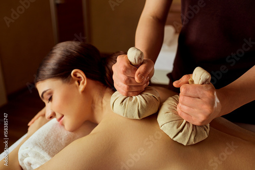 Close-up of a girl massage in spa salon.