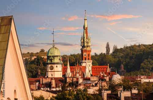 Fotobehang Krakau Roofs of the churches in sunset time. Krakow