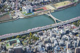Tokyo aerial view of blossoms cherry tress by the river with bridge, Japan