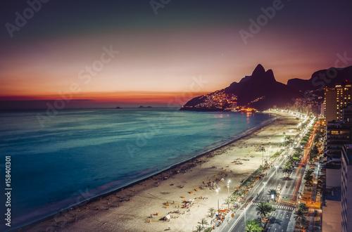 Sunset on Ipanema Beach and coastline street, Rio de Janeiro, Brazil Poster
