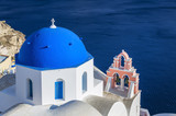 Blue dome traditional church with ocean background in Oia, Santorini Island, Greece