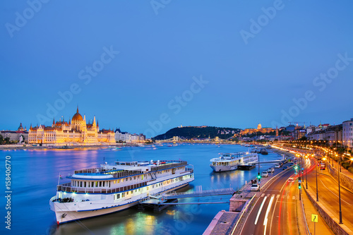 Sticker Travel and european tourism concept. Parliament and riverside in Budapest Hungary with sightseeing ships during blue hour sunset