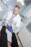 Podiatrist pointing to patient's toes
