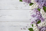 A wooden background with flowering lilac branches - 158410931