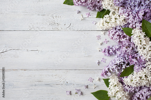 A wooden background with flowering lilac branches Plakat