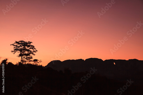 Poster Koraal Sunset mountains landscape.
