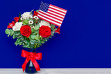 Beautiful bouquet with american flag on blue background - 158443763