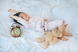 cute little girl unwilling to wake up in the morning.