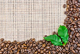 Coffee black grains on brown woven fabric