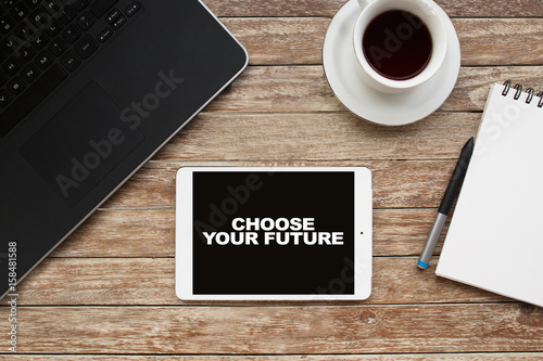 Tablet on desktop with choose your future text. Poster