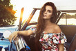 Beautiful woman sitting inside retro car