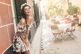 Fototapeta Happy woman in beautiful dress on the street