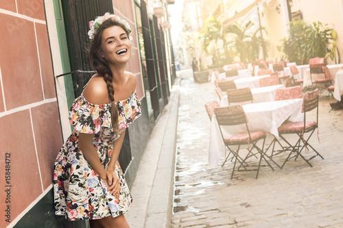 Happy woman in beautiful dress on the street