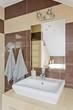Quadro Modern bathroom with beige tiles