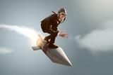 Fototapeta Mann auf Rakete