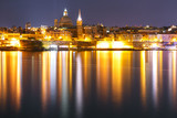 Valletta Skyline at night from Sliema with church of Our Lady of Mount Carmel and St. Paul's Anglican Pro-Cathedral, Valletta, Capital city of Malta