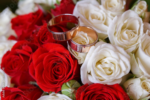 luxurious bouquets of roses and gold rings for a romantic rendezvous couples Poster
