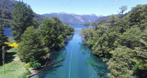 Poster Oceanië Aerial drone scene of ruca malen river tributary of Correntoso lake, Patagonia argentina. High view of turguioise, transparent, cristal clear river and native woods of Lanin national park. Ruta 40.