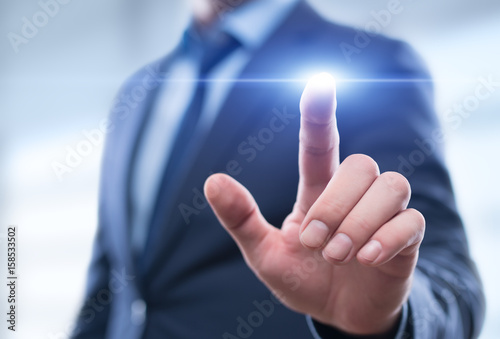Businessman pressing button on virtual screen. Man pointing on futuristic interface. Innovation technology internet and business concept. Space for text and words. Abstract background.