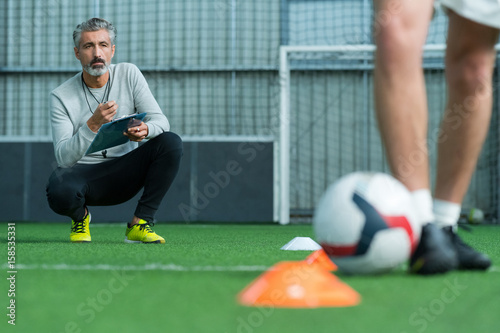 Fotobehang Voetbal football coach training football player