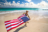 Enjoying woman celebrate independence day waving American flag in tropical Hawaiian beach. Lanikai Beach, east shore of Oahu in Hawaii, USA. Freedom and patriotic concept. Indipendence day. - 158582990