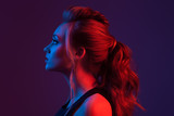 Fashion portrait of beautiful woman. Hairstyle. Blue and red light.
