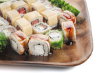 Sushi set on wooden plate