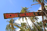 """Travel to island Koh Lanta, Thailand. An inscription """"Don't worry"""" on the wooden abandoned hut."""
