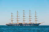 The large sailing ship with five masts anchored in the open sea near old city Piran, Slovenia