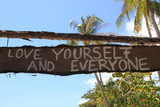 "Travel to island Koh Lanta, Thailand. Inscriptions ""Love yourself and everyone"" on the wooden abandoned hut."