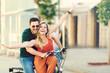 Happy Couple Riding a Bike - 158595547