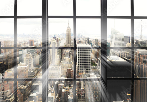 Fototapeta Large panoramic window with views of the city