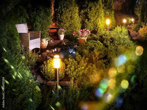 Foto Murales Illuminated home garden fountain patio