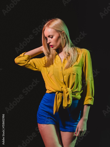 girl with red lips and blonde hair in studio Poster