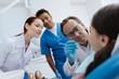 Attentive dentist doing teeth examination