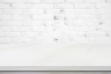 Empty white marble table over brick wall background, product display montage