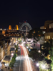 View of The Rocks and Sydney Harbour Bridge at night.
