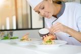 Chef preparing dish in professional kitchen