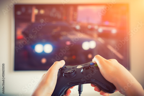 Player playing console car race videogame holding gamepad Poster