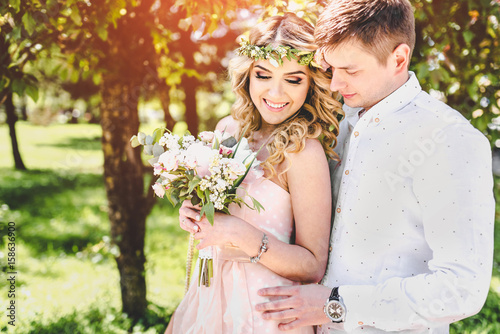 Pretty young wedding couple outdoor in the park