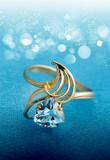 Elegant female jewelry ring with blue topaz