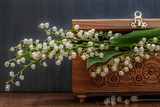 carved wooden jewelry box with Lily of the valley