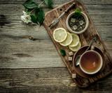 jasmine tea with lemon in brown cup, copyspace