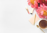 woman desktop with coffee,flowers, lipstick, notebook. top view