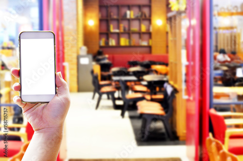 Hand holding smartphone for finding the restaurant shop Poster