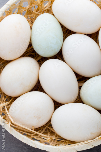 Duck eggs on a cage gray background. - 158758131